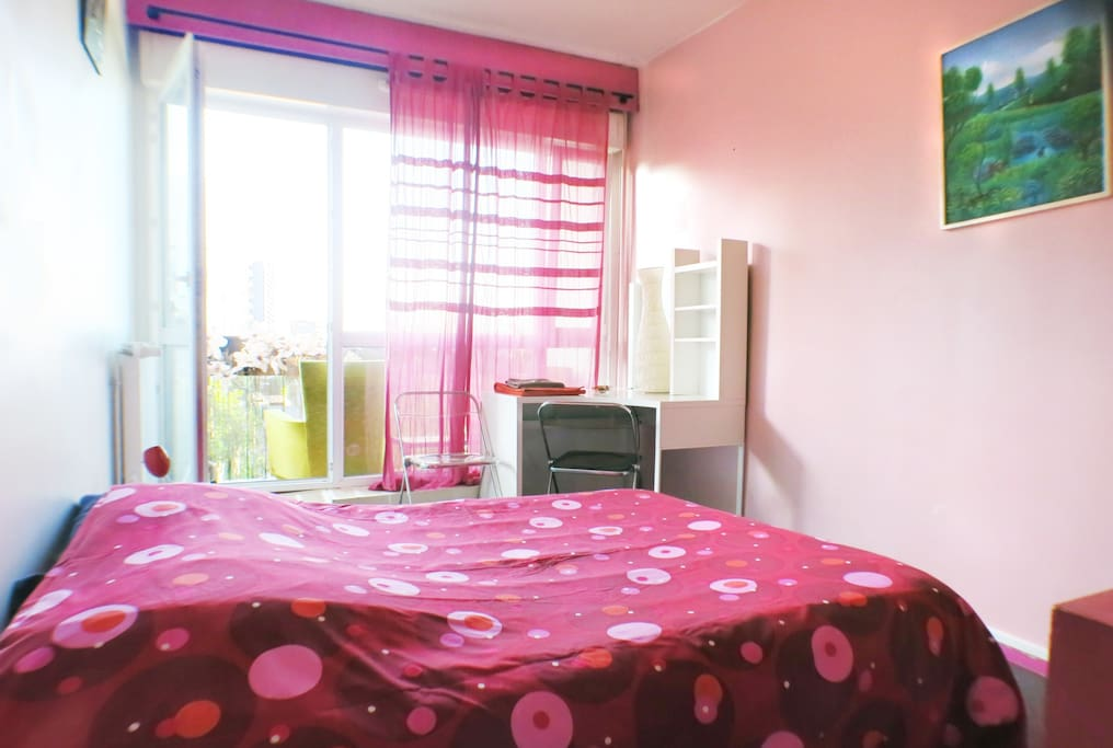 The Bedroom with Balcony (behind the curtains)