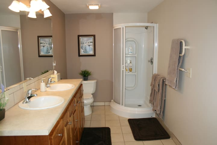 Extra large bathroom with a heated towel rack.