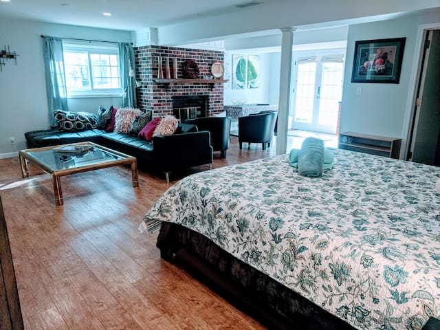 Showcasing the main entrance, which opens up to the dining table and the kitchen. Cozy up next to the fireplace, or spread out on the couch watching a movie. Tuck in to a king sized bed.