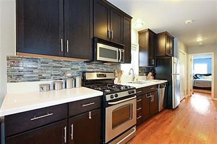 Just renovated the kitchen.  It has everything you would need to whip up a meal, make coffee, or just crack open a bottle of wine and order take out.  Also have a GREAT grill on one of the 3 decks  if you want to cook out.