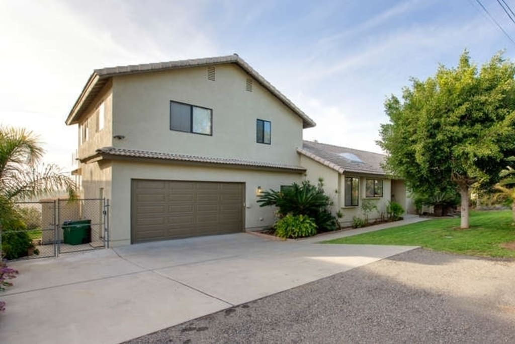 The home is at the end of a quiet neighborhood street in Olde Carlsbad. There is ample space for 2 cars double parked on the left side of the driveway (not blocking garage), and enter through the gate on the left. Your Carlsbad retreat residence is above the garage.