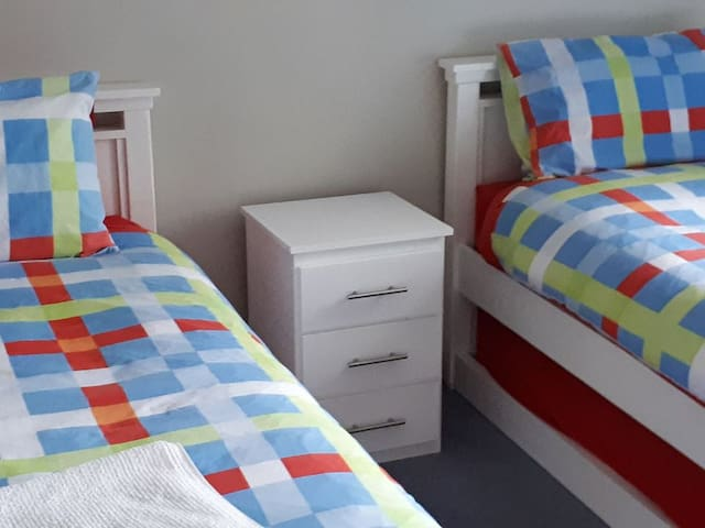 Bedroom 3 has twin beds and trundles