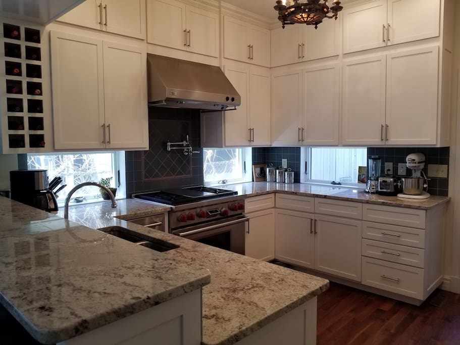 Gourmet kitchen with Wolf range, under counter ice maker, & all the appliances for cooking at home