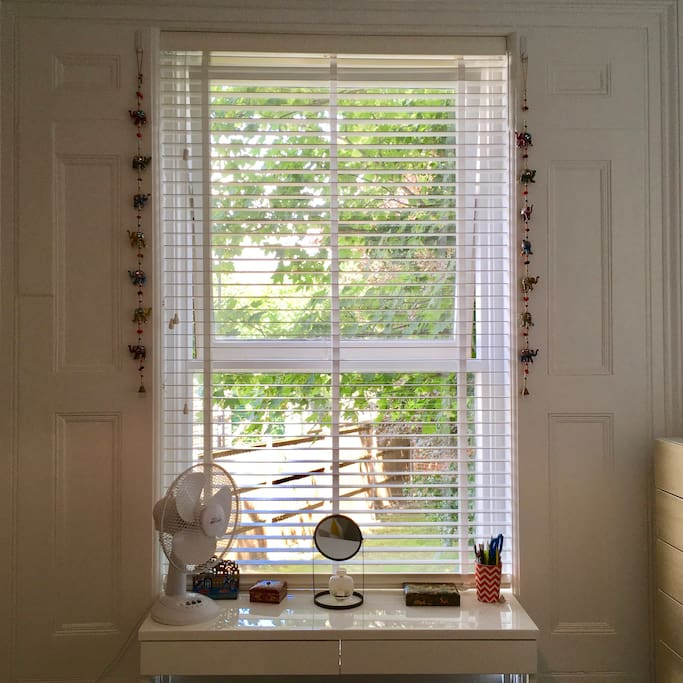 Dressing table by bedroom window