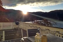 View from the deck in November. It is 11:00 am and the sun is up only a few hours, barely looking over the mountains.