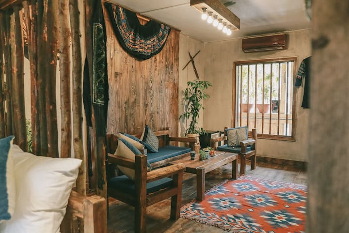 Living room, the wooden chair is decorated in Sapa style