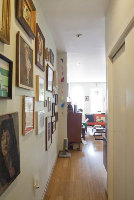 Wonderful works of art, mostly vintage, hang on the wall in the entrance hallway.