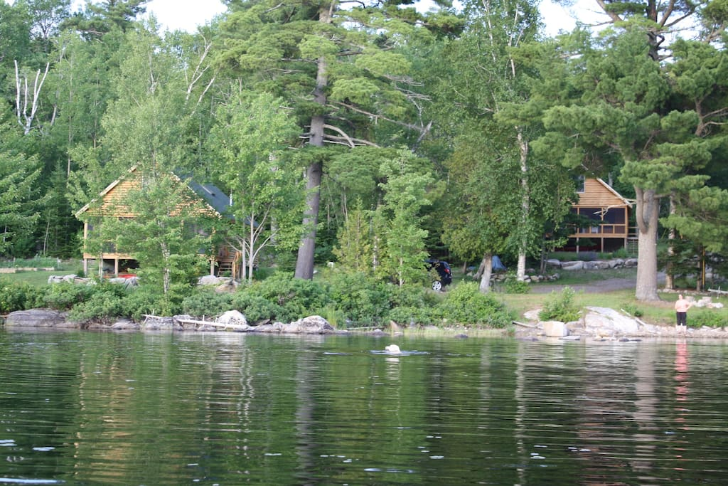 Two cabins right on the lake. The one on the right is the one you stay in.