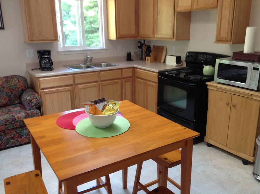 Kitchen includes cookware and dishes.