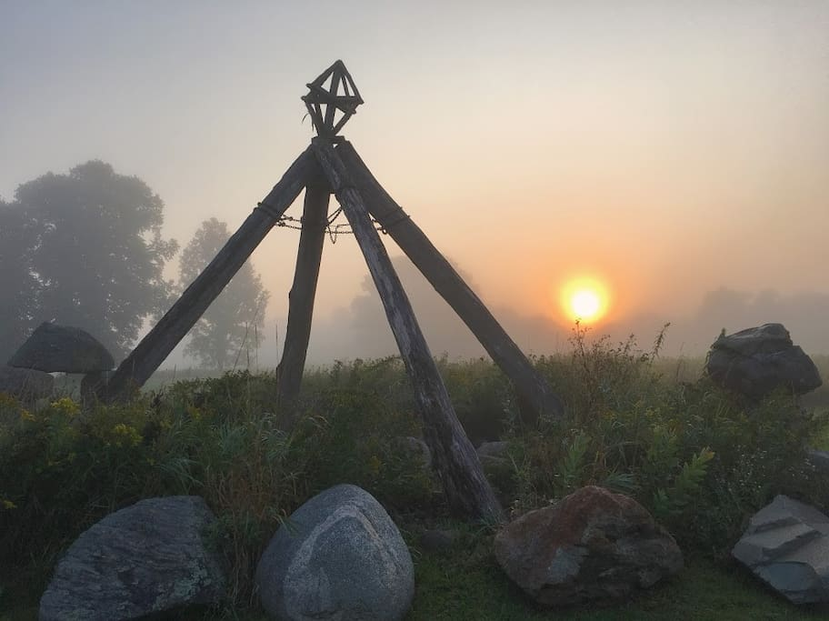 Sculptures and the setting sun