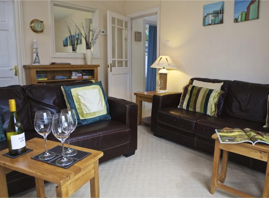 Sitting room has 1 double & 1 triple leather sofa and a selection of board games