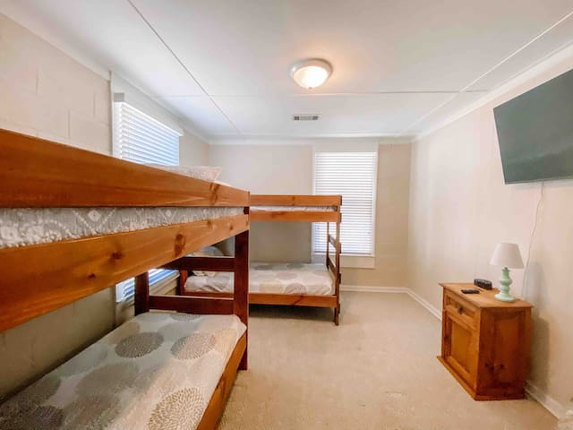Bunk room with roku and large screen tv