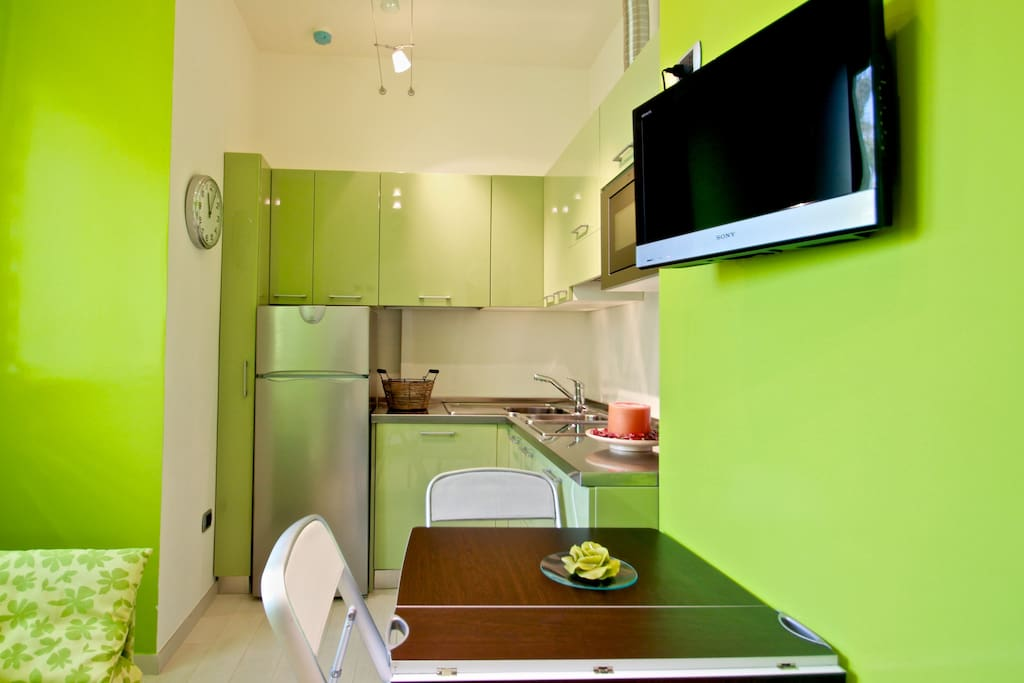 Fully equipped  kitchen with folding sofa bed