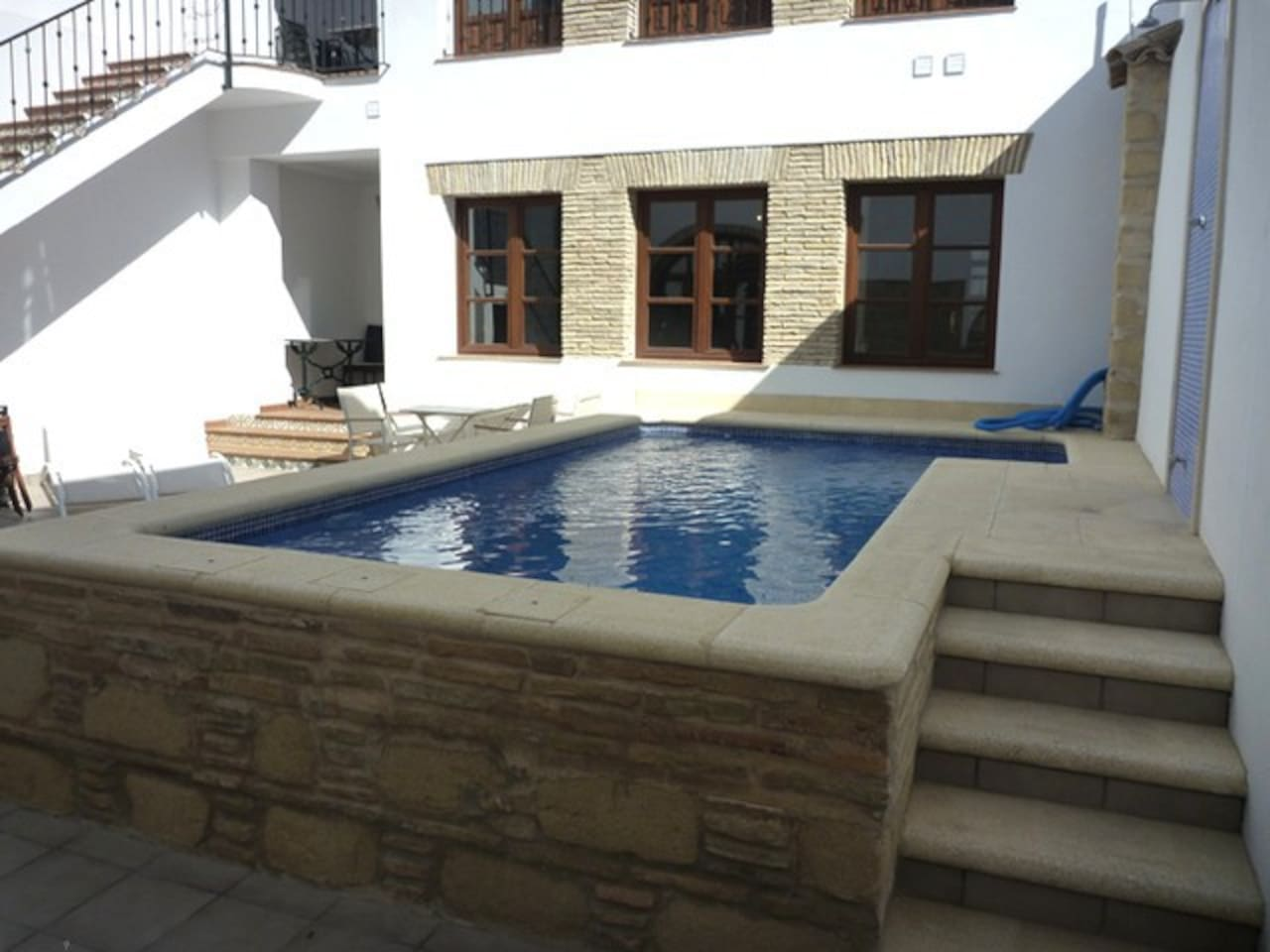 A small swimmingpool just outside the apartment.