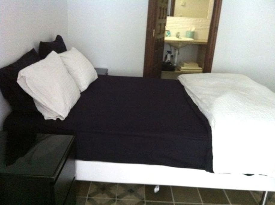 1 bedroom with a double bed and attached bathroom.