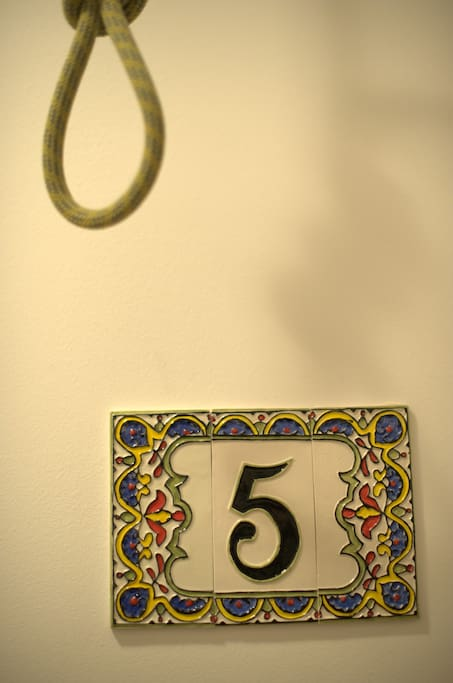 Glazed ceramic number adores entry to every room.