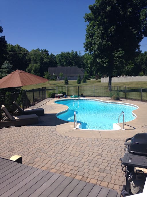Inground pool. 2 lounge chairs as well as 2 more chairs to this set have been added.
