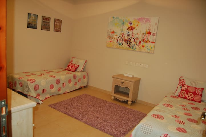Two single beds, for adults or kids, could be pulled together.