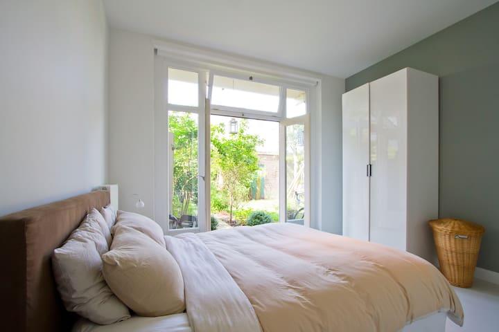 Sleepingroom with French doors to backyard