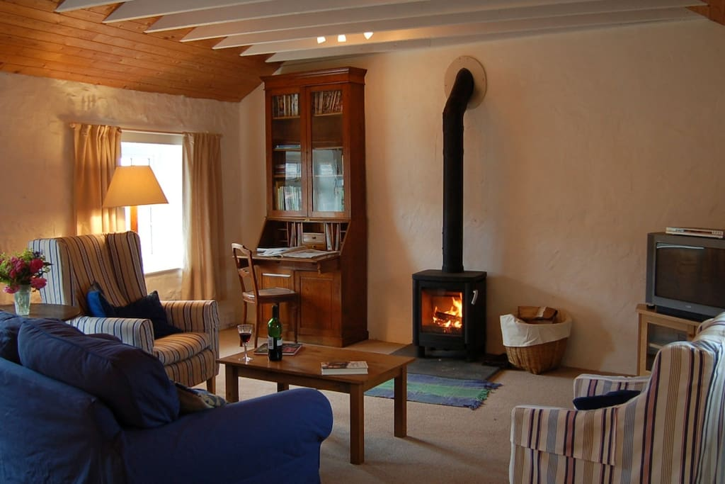 The SITTING ROOM with its log burner, television, wi-fi and i-pod dock.