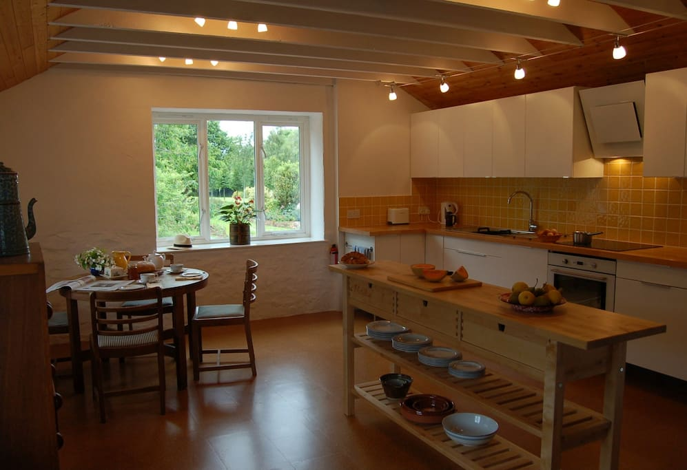 The well-equipped KITCHEN and eating area.