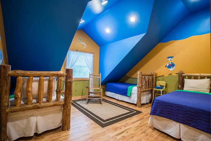 Kid disney theme room, but 3 twin beds are suitable for adults