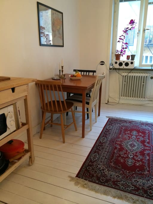 Kitchen with table for three.