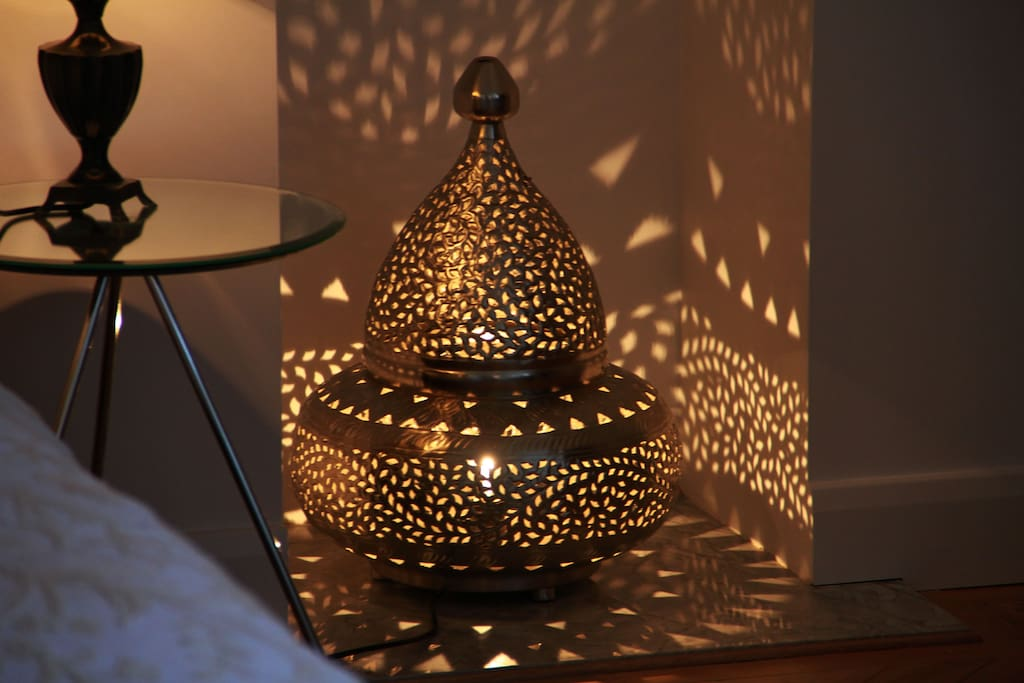 ...and a Moroccan lamp in the fireplace.