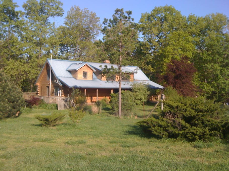 House sits on 80 acres with trails.
