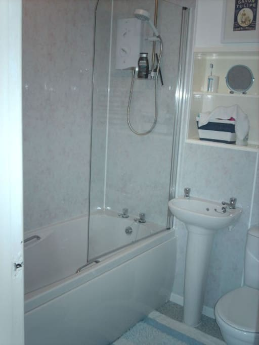 Modern bathroom, recently refurbished, with over bath shower.