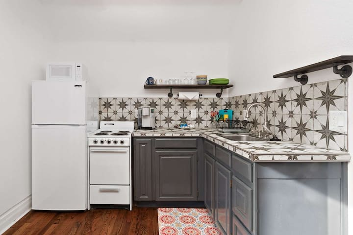 Every detail masterfully executed in this small space, from appliances to this enchanting tile.