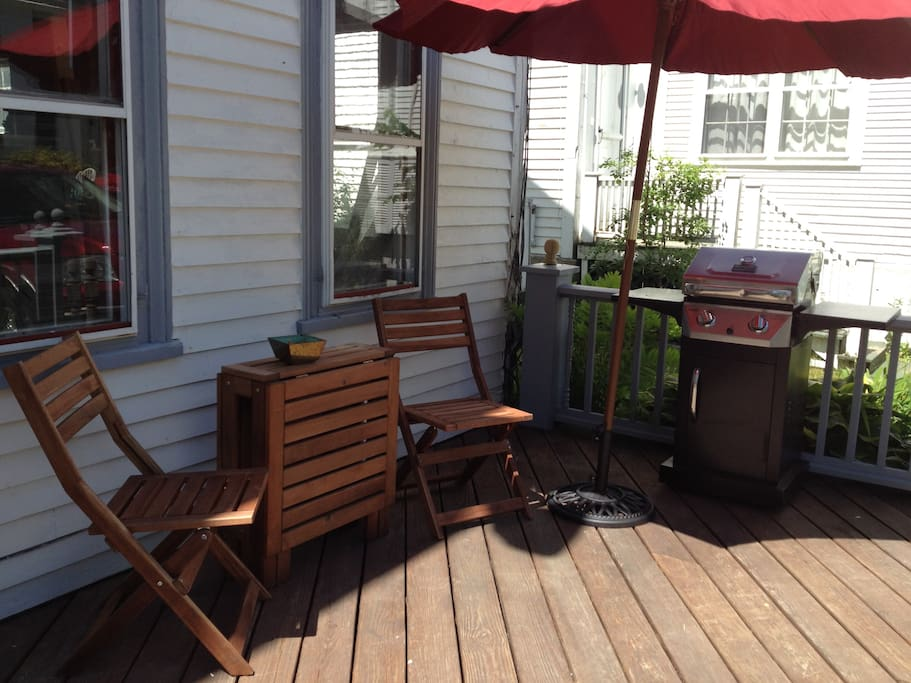 Front porch with seating area for 2, umbrella, and propane BBQ