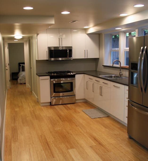 Fully stocked kitchen. Gas stove & oven, microwave, coffee maker, fridge, and dishwasher.