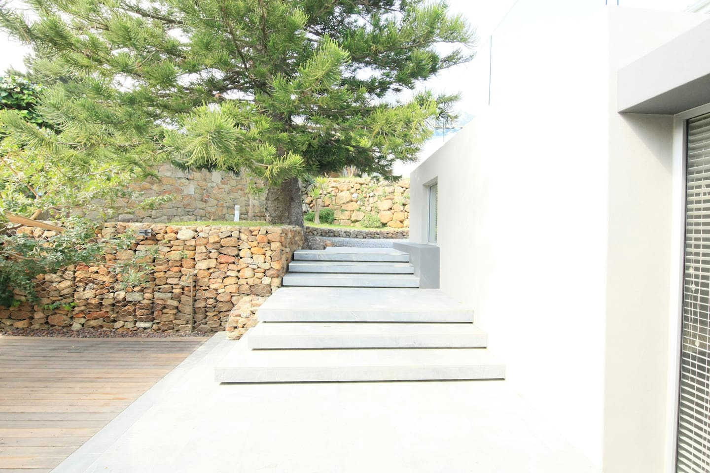 steps to the main residence separating the  guesthouse from the secure gardens of the owner's 1,300sqm Camps Bay property