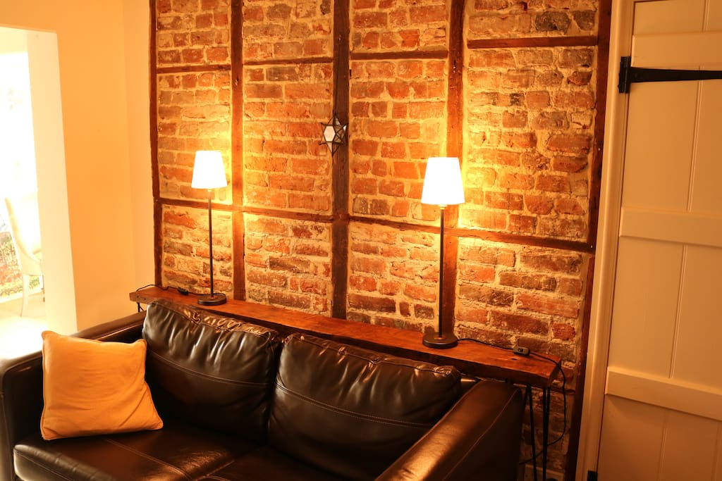 Living room with exposed brick and timber wall