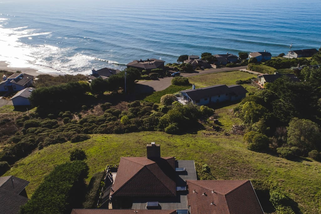 The home is located on a west-facing bluff overlooking the Pacific with ocean views from almost every room.