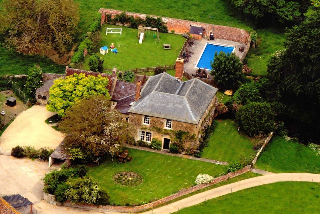 An aerial view of Clanville Manor and the swimming pool.
