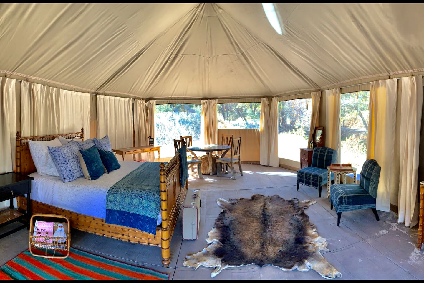 This is the inside of the Howard Creek Tent. It sits outside Howard Creek which flows all year round.  It has a screened porch as well as a barbecue pit and picnic table.
