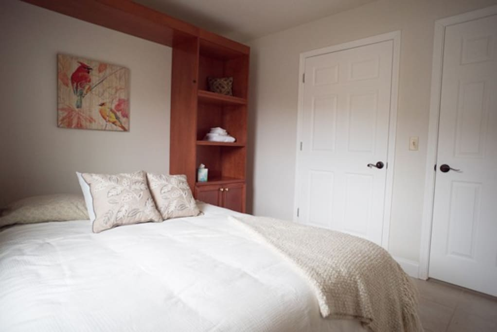 Murphy bed (can fold up against wall for day-use of room)