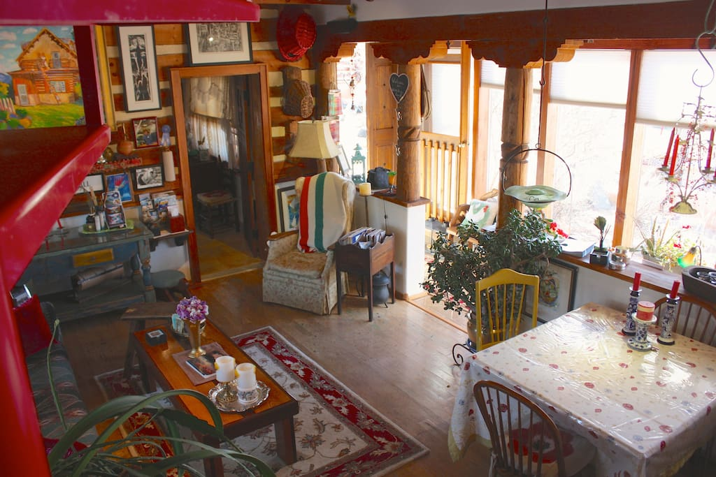 View from the spiral staircase of the living and dining area downstairs.