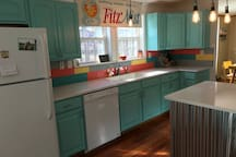 Fully equipped kitchen with full sized refrigerator, stove, dishwasher, microwave, toaster oven and coffee maker