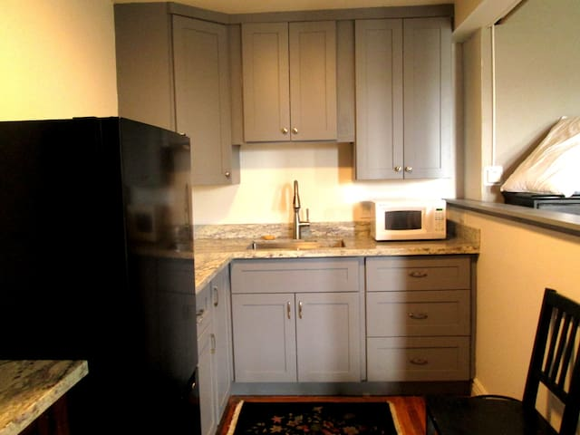 New kitchen with granite counters; full size refrigerator with freezer.