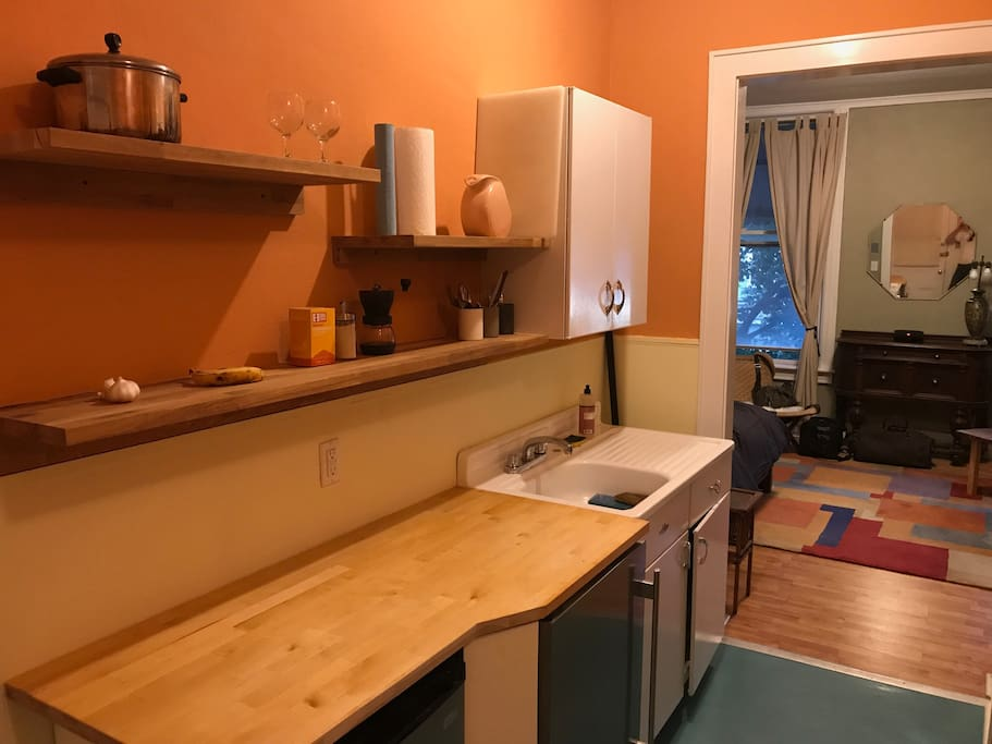 The 50's-style kitchen was inspired by a big old sink and drying rack.