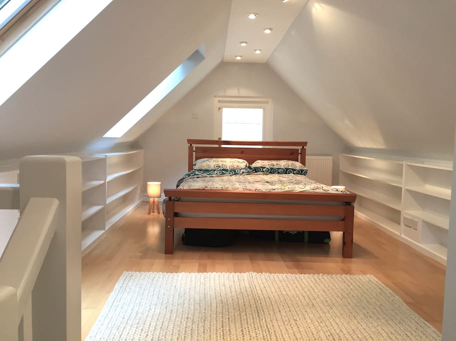 Large double bedroom with ensuite bathroom and private balcony access