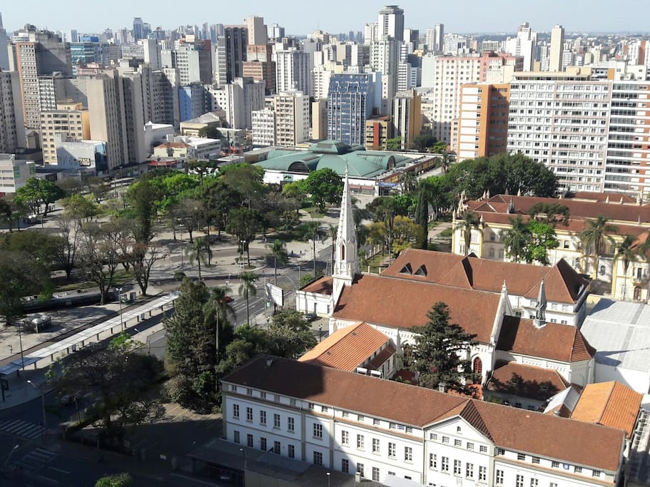"""20th floor balcony view facing North part of Curitiba, also the amazing view of Rui Barbosa park, bus terminal and mall, and the church """"Bom Jesus dos Perdões""""."""