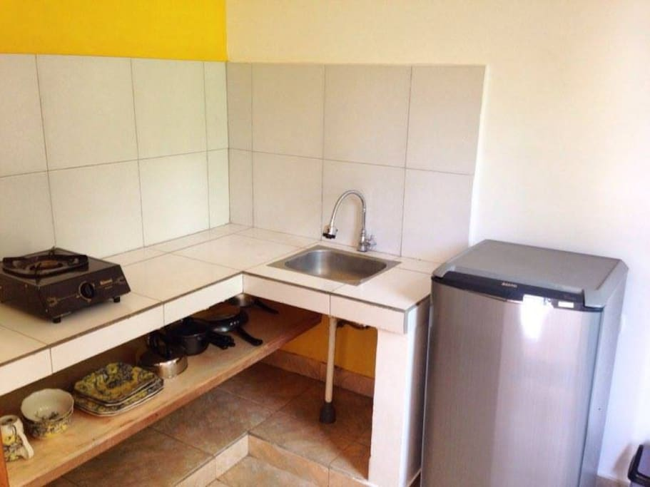 Private small kitchen with hot plate, fridge, and essentials