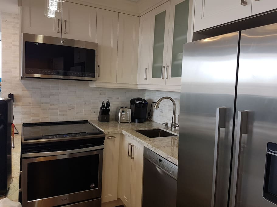 High-end Italian kitchen with granite countertops and all new stainless steel appliances