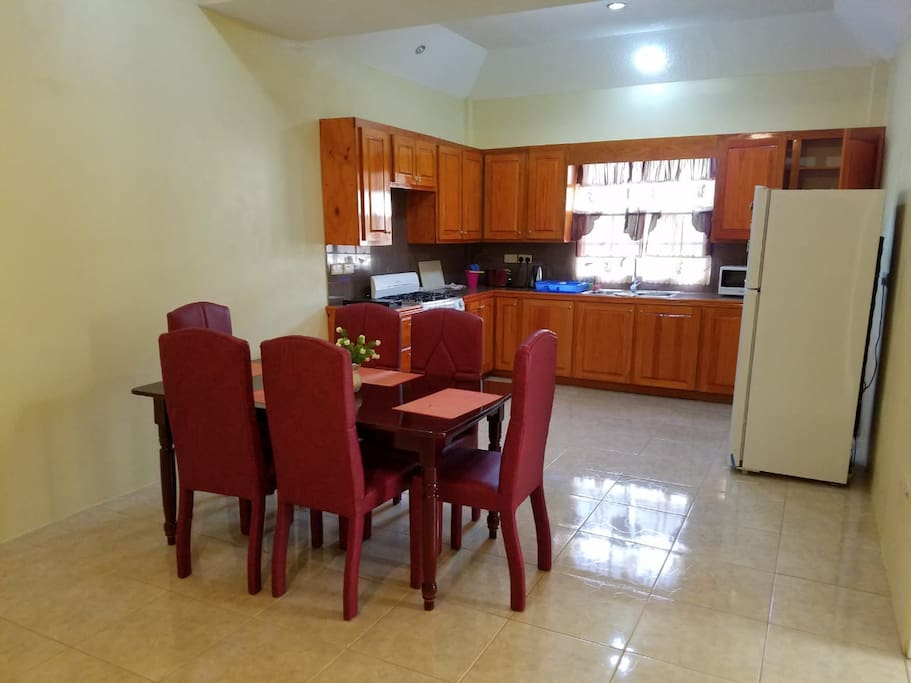 Dining area with 6 seater dining set and kitchen