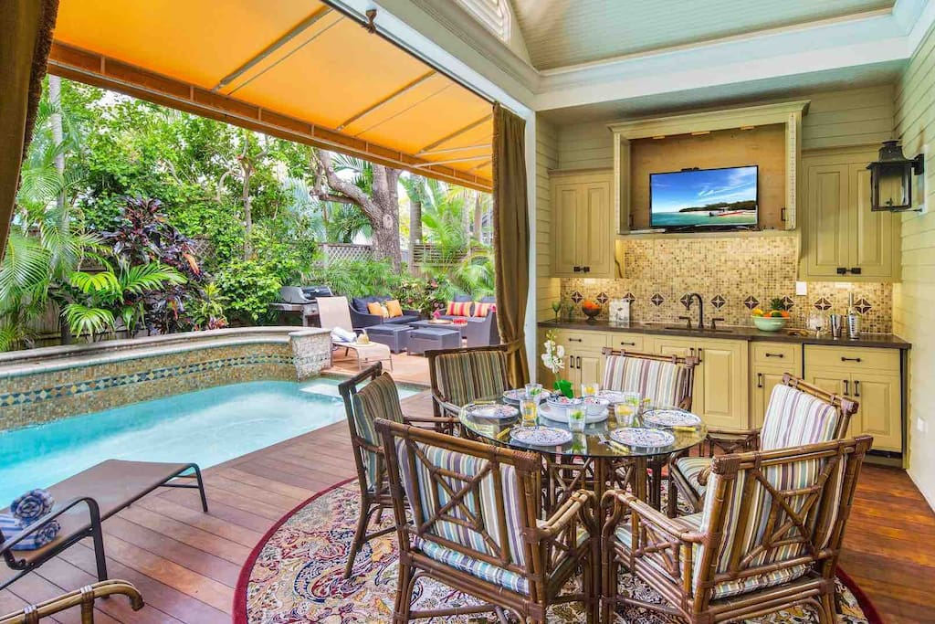 The covered lanai has an outdoor TV and wet bar...