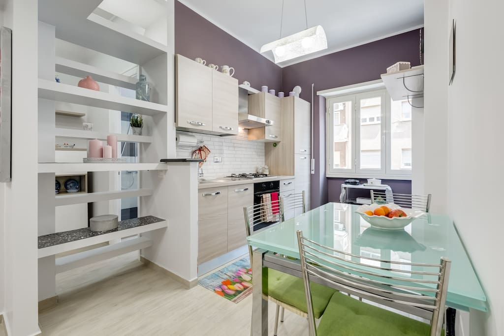 The kitchen is well-equipped with appliances and utensils